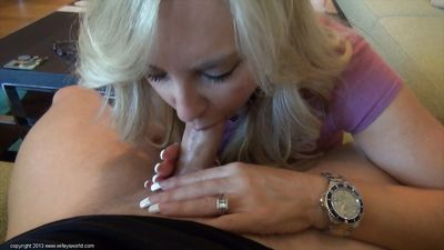 Lewd blonde housewife milking a stiff cock with her mouth and hands