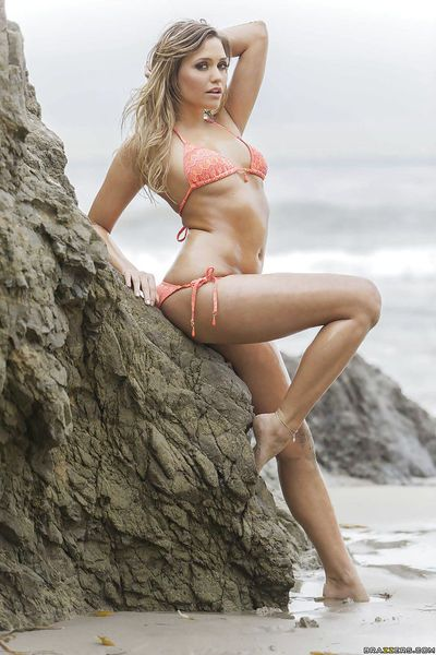 Outdoor posing scene with an astounding bikini model Mia Malkova