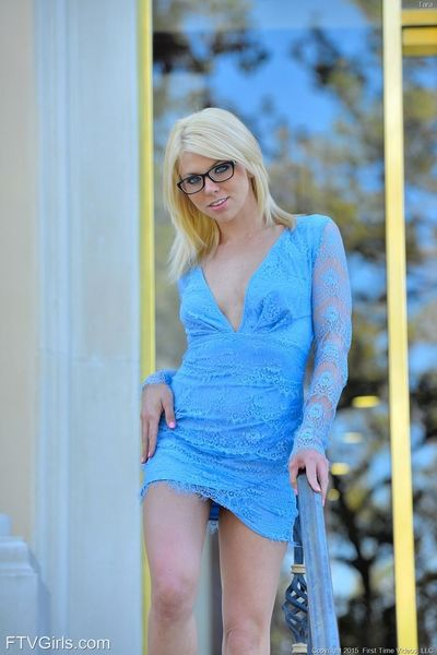 Blonde girl in glasses gives nude pussy upskirt and flaunts tits outdoors