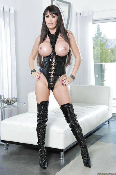 Terrific European babe with big tits Eva Karera wears sexy high boots