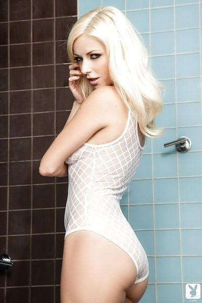 Dainty blondie getting wet and uncovering her petite curves in the shower