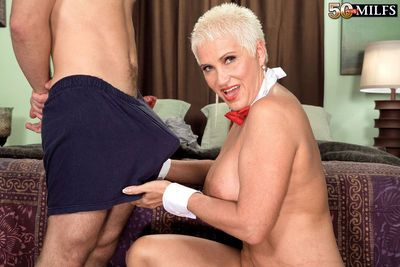 Short-haired mom Trinity Powers is happy to suck big dick of a young dude