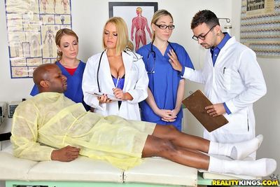 Gorgeous doctor and horny nurses take turns sucking and fucking a big cock