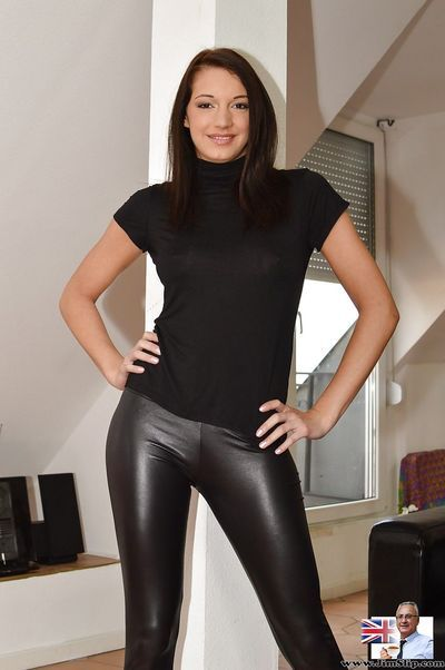Dark haired model flashing natural tits before pulling down black latex pants