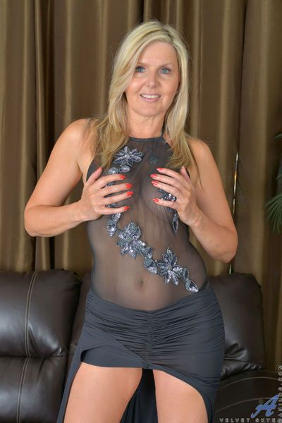 Older blonde MILF sheds sheer lingerie and lace panties to model naked