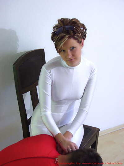 Dominant females force an older submissive male to submit during BDSM play