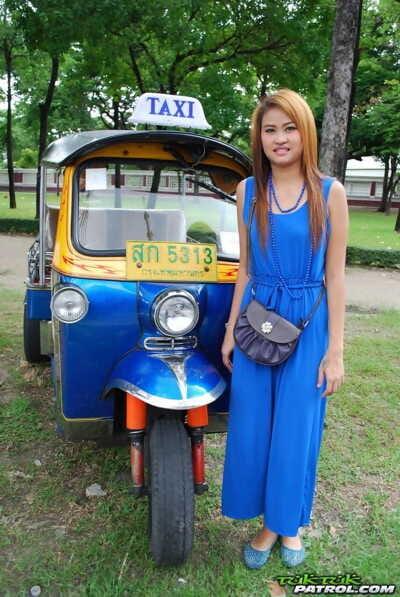 Beautiful Thai girl Mon flirting with a cute male tourist in public