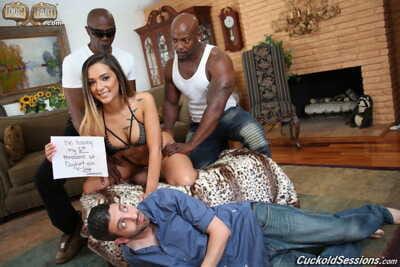 Hot slut strips her bikini to engage in raunchy interracial cuckold groupsex