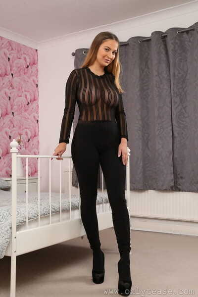 Hot bae Suzie Q flashes her massive knockers and poses in black pantyhose