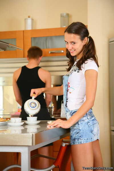 Young brunette seduces her stepbrother for sex in the kitchen