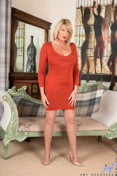 Stunning mature Amy Goodhead removes her red dress and showcases her curves