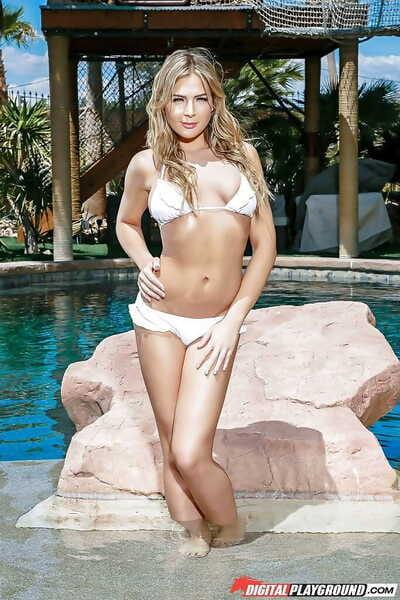 Top pornstar Blair Williams showing off great legs outdoors in bikini