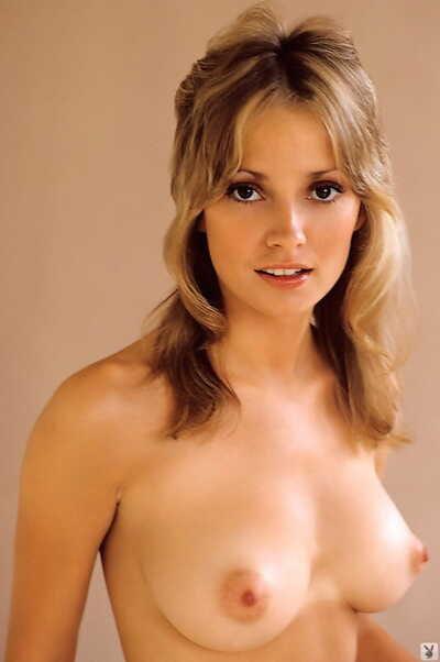 Big-eyed busty centerfold Cyndi Wood poses naked to show her big tits & bush