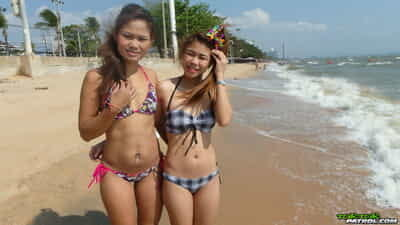 Delicious teenage Thai babes Bee and Miaw posing at the beach in hot bikinis