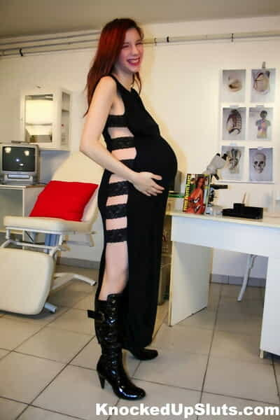 Pregnant redhead gets fucked in the doctors examination room in boots
