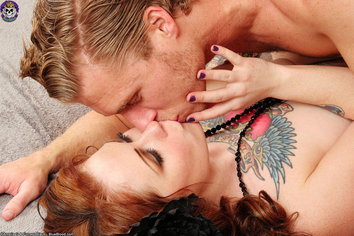 Erotic tattooed counterculture couple sex