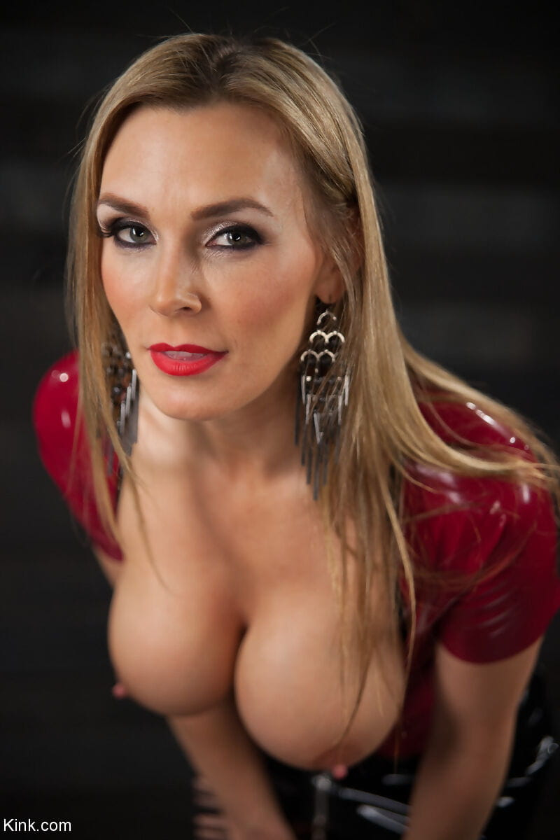 British model Tanya Tate releases her big tits from latex clothing