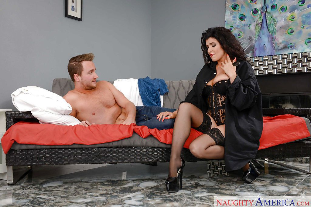 Busty stocking clad brunette Romi Rain receiving hardcore cumshot
