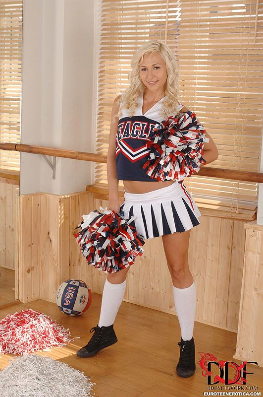 Blonde Euro cheerleader Tracy Delicious flaunting nice coed ass in socks