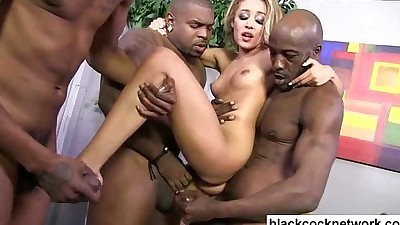 Two black cocks force their way..