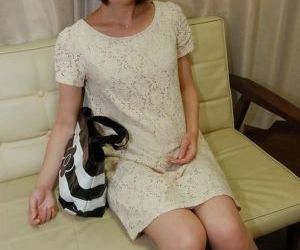Stunning short-haired model Mari Suzui is masturbating her..