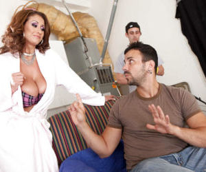 Hot MILF Eva Notty gets a cumshot on her massive boobs..