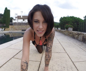 Tattooed MILF solo girl Nikita Bellucci showing off nice..