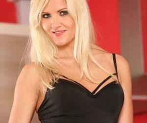 Blonde amateur lifts up her black dress to finger her bald..