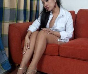 Asian looking Amy Latina removes her high heel sandals to..