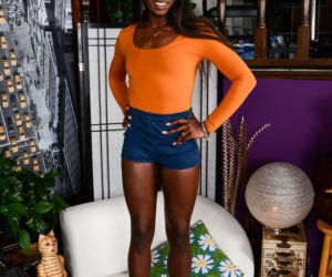 Black female Ana Foxxx slides her denim shorts and pink..