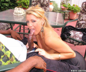 Outdoor Interracial sex scene with a mature cowgirl..