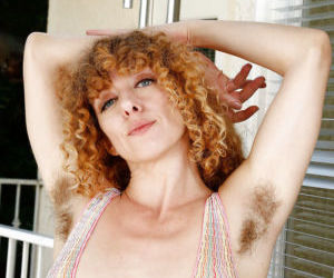 Hirsute natural redhead Leona spreading hairy pink pussy..