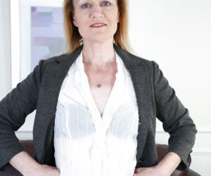 Mature lady Clare Cream undresses and touches her snatch..