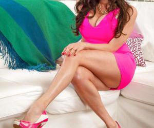 Latina MILF Ariella Ferrera letting huge knockers loose..
