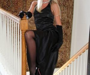 Stocking garbed mature blonde revealing tiny tits and..