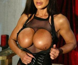 Vampish pornstar in pantyhose suit Lisa Ann has some fun..