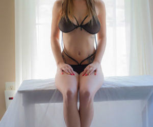 Cute amateur in glasses bares her big tits and fondles..