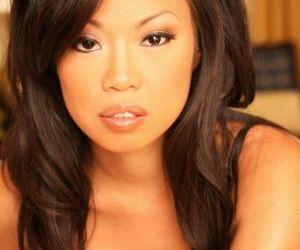 Brunette Asian Kyara Coast dose some posing in her sexy..