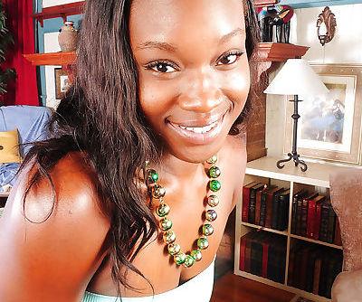 Amateur black model Lyric displaying pink vagina after undressing