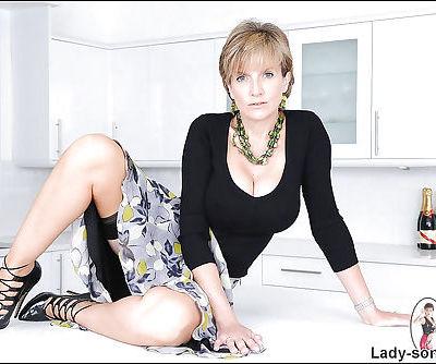 Lusty mature lady in nylon stockings masturbating her slit