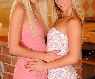 Two girls in sundresses are eager for the taste of shaved young pussy