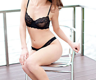 Slender redhead girl with milky skin looks gorgeous and seductive in her black lingerie