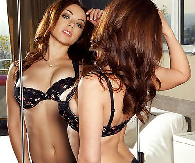Exquisite redhead babe Gigi Marie pulls back her bra and panties to reveal her magnificent qualities