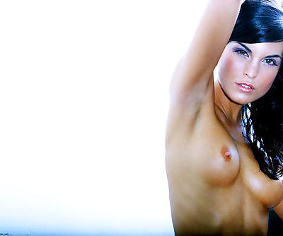 Dark-haired girl is naked and her youthful body is tight and beautiful