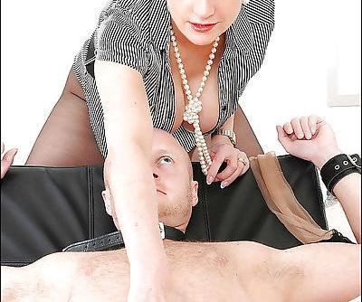 Busty mature femdom stroking and torturing her male pets cock