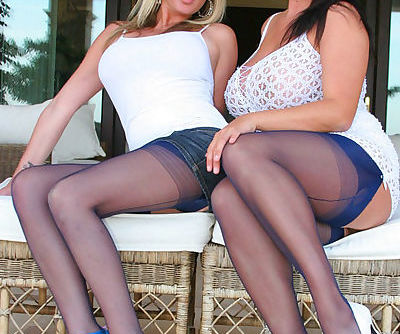 Beautiful and classy lesbian mature ladies plays outdoors wearing same expensive lingerie and stockings.