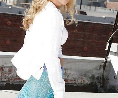 Stunning blonde pornstar Jessica Drake uncovering her gorgeous body