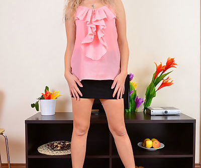 Middle-aged blonde lady Angel Diamonds doffs her miniskirt and sheer panties