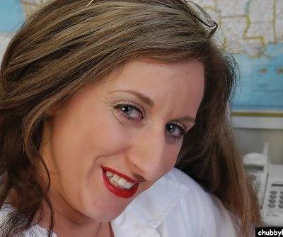 Older woman Kitty revealing meaty labia lips after disrobing in home office